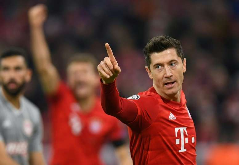 Lewandowski helps fire Bayern into Champions League last 16. AFP