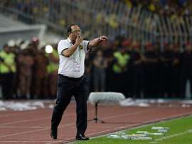 The coach of Malaysias national football team, Dollah Salleh, has announced his resignation after his squad was thrashed 10-0 by the United Arab Emirates