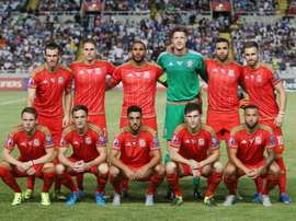 Wales players pose for a group picture ahead of the EURO 2016 qualifying football match between Cyprus and Wales at the GSP stadium in the Cypriot capital Nicosia on September 3, 2015