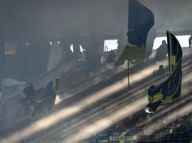 Hellas Verona supporters cheer in the stands during a Serie A football match in Verona on January 26, 2014