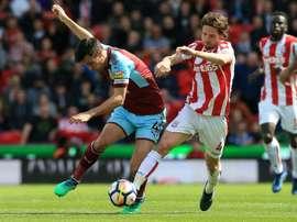 Joe Allen in action against Burnley. AFP