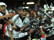 Orlando Pirates supporters celebrate on November 2, 2013