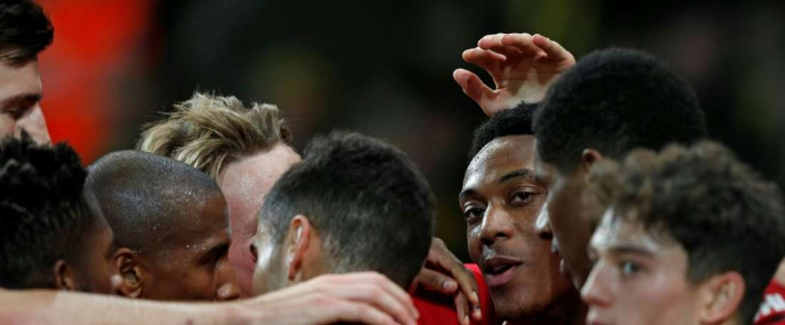 Martial got on the scoresheet and missed a penalty in Man Utd's 1-3 win over Norwich. AFP