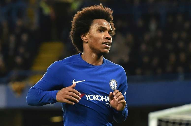 Willian insists he never wanted to leave the 'Blues'. AFP