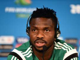 Nigerias defender Joseph Yobo answers a question during a press conference before a training session at the Pantanal Arena in Cuiaba, Brazil on June 20, 2014