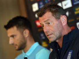 Andreas Samaris (L) rejoins the Greek national football team in the line up announced by head coach Michael Skibbe (R)tain Andreas Samaris (L) attend a press conference in Sydney on June 3, 2016.Australia play Greece in a double-header football international friendlies in Sydney on June 4 and in Melbourne on June 7.