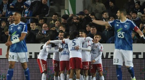 Lyon are just two points off third after coming from behind to defeat Strasbourg. AFP