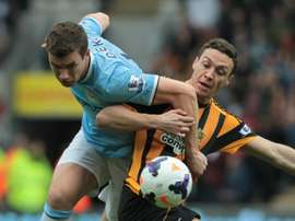 Hull Citys English defender James Chester (right) vies with Manchester Citys Bosnian striker Edin Dzeko during their English Premier League match at the KC Stadium in Hull on March 15, 2014