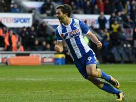 Grigg scored twice as Wigan downed West Ham. AFP