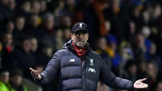 Liverpool were warned over possible winter break clash: FA. AFP