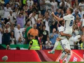 Real Madrids German midfielder Toni Kroos celebrates after scoring during the Spanish league football match Real Madrid CF vs RC Celta de Vigo at the Santiago Bernabeu stadium in Madrid on August 27, 2016