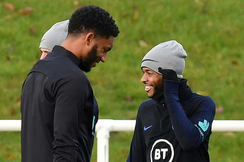 Klopp says there is no ill feeling between Joe Gomez (L) and Raheem Sterling. AFP