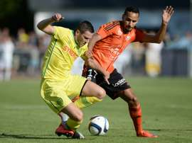 Nantes midfielder Jordan Veretout (L) vies with Lorient midfielder Walid Mesloub during the friendly at the Moreau-Desfarges stadium in La Baule-Escoublac, western France on July 22, 2015