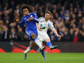 Dynamo Kievs Portuguese defender Antunes (R) clears the ball past Chelseas Brazilian midfielder Willian during a UEFA Chamions league group stage football match at Stamford Bridge stadium in west London on November 4, 2015