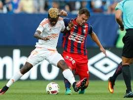 Lorient Gabonese midfielder Didier Ndong (L) is tackled by Caen defender Damien Da Silva. AFP