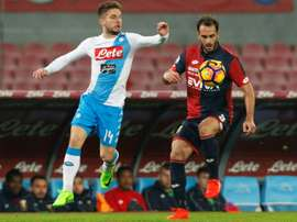 Napolis Dries Mertens (L) fights for the ball with Genoas Santiago. AFP