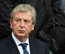 Hodgson's side are closing on on a triple deal. AFP