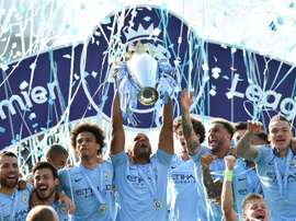 Manchester City with the Premier League title at the end of last season. AFP