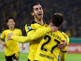 Dortmunds midfielder Gonzalo Castro celebrates scoring with midfielder Henrikh Mkhitaryan during the German Cup DFB second round football match in Dortmund, western Germany on October 28, 2015