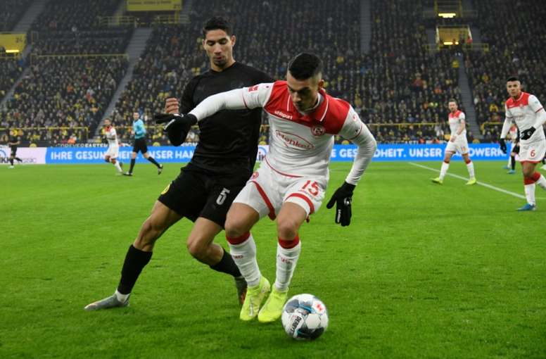 Late strike gives Duesseldorf first league win since November. afp