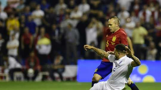 Midfielder Andres Iniesta (L), was the hero of the 2010 World Cup for Spain