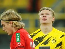 Erling Haaland (R) has got a hamstring injury. AFP
