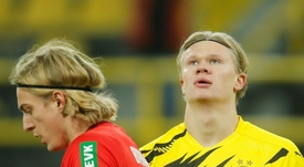 Erling Haaland (R) has got a hamstring injury. AFP