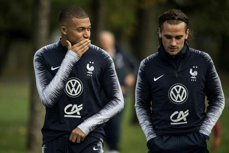 Mbappe (L) has pulled out of the France squad as he is not fit. AFP