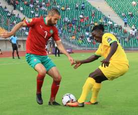 Moroccan Zakaria Hadraf (L) and Togolese Ayayi Zonor contest possession. aFP