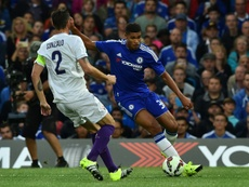 Chelseas midfielder Ruben Loftus-Cheek (R) shoots around Fiorentinas defender Gonzalo (L) but misses the chance during the pre-season friendly at Stamford Bridge in London on August 5, 2015