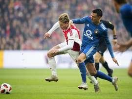 Ajax and Netherlands star Frenkie de Jong (L) in action against Feyenoords Steven Berghuis (R). AFP