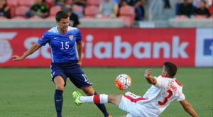 Giuliano Frano (R) of Canada directs the ball away from Marc Pelosi of the US during the first half of the third place CONCACAF Olympic qualifying match, at Rio Tinto Stadium in Sandy, Utah, on October 13, 2015
