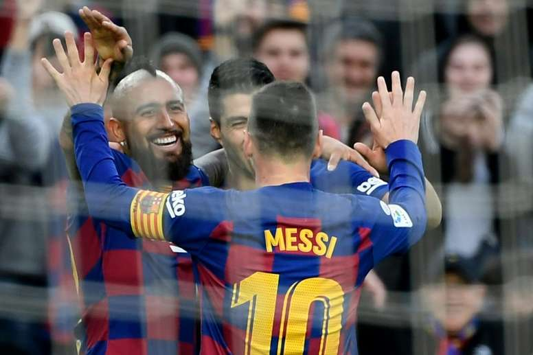 Messi shines in sparkling Barcelona Christmas stroll. AFP