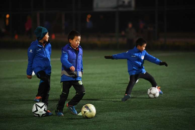 Boys attend a training session at a football club in Beijing. AFP