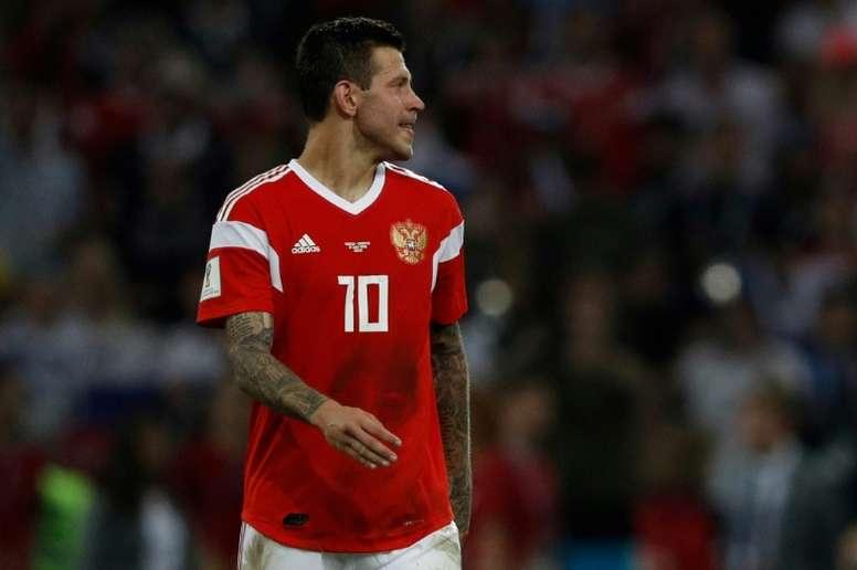 Smolov, fuera tres semanas por lesión. AFP