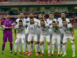 Greeces players line up for photographers before the start of the friendly football match between Turkey and Greece at Basaksehir stadium on November 17, 2015 in Istanbul