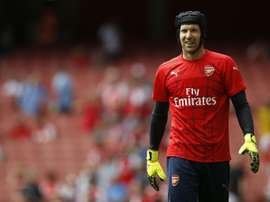 Arsenals Czech goalkeeper Petr Cech warms up before the start of their English Premier League football match against West Ham United at the Emirates Stadium in London on August 9, 2015
