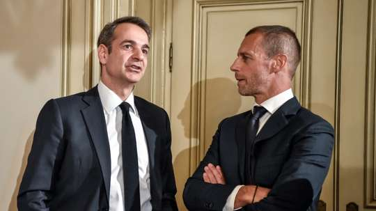 The Greek governmment and the UEFA head will try and clear up Greek football. AFP