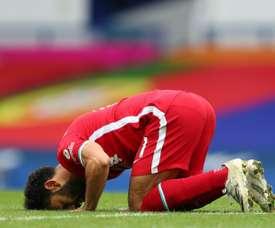 Egyptian Mohamed Salah celebrates his 100th Liverpool goal. AFP
