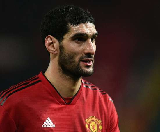 Fellaini flew back from Hong Kong to Belgium for treatment. AFP