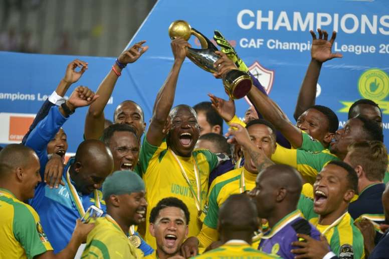 Mamelodi Sundowns players celebrate with the trophy after winning the CAF Champions League football competition following the final match against Egypts Zamalek on October 23, 2016