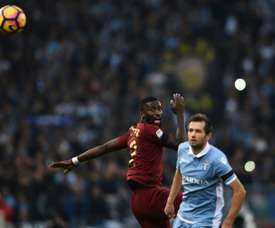 Romas defender from Germany Antonio Rudiger (L) vies with Lazios midfielder from Bosnia-Herzegovina Senad Lulic during the Italian Serie A football match SS Lazio vs AS Roma on December 4, 2016