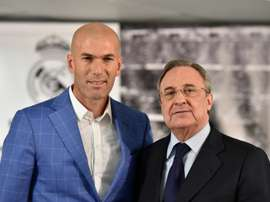 Real Madrids new coach Zinedine Zidane (L) poses with Real Madrids president Florentino Perez after a statement at the Santiago Bernabeu stadium in Madrid on January 4, 2016