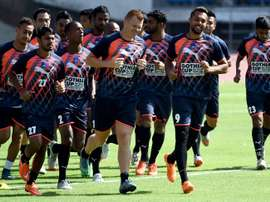 Delhi Dynamos FC players warm up during a training session at the Jawaharlal Nehru Stadium in New Delhi on September 30, 2015