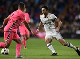 Real Madrids midfielder Enzo Zidane (R) vies with Cultural Leonesas defender Angel Bastos during the Spanish Copa del Rey (Kings Cup) Round of 32 second leg football match Real Madrid CF vs Cultural y Deportiva Leonesa on November 30, 2016