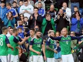 Northern Irelands striker Liam Boyce (R) celebrates with teammates. AFP
