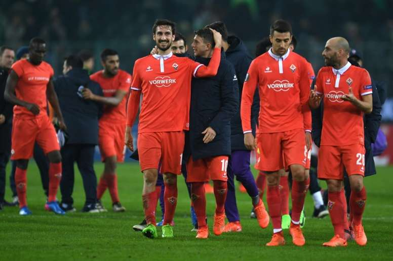 Fiorentina's players celebrate after a match. AFP
