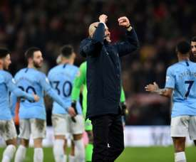 Guardiola celebrated the win on the pitch. AFP