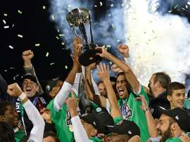 Spanish soccer star Raul (R holding trophy) celebrates with his teammates after the NASL Championship Final match between the NY Cosmos and the Ottawa Fury November 15, 2015 in Hempstead, NY