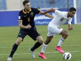 Jordans Hasan Abdel-Fattah (C) dribbles past Australias Matthew Spiranovic during the AFC qualifying football match for the 2018 FIFA World Cup on October 8, 2015 at the Amman International Stadium in the Jordanian capital